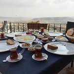 Breakfast is served at the hotel's terrace with a amazing view and is very delicious