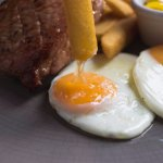 Smoked bacon chop, fried eggs, piccalilli, thick-cut chips