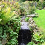 The stream in the attractive landscaped gardens.