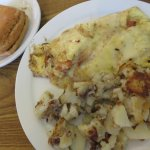 Tomato and pepper jack omelet with home fries and a square croissant