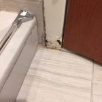 Rotting of door frame due to water damage.