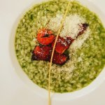 Pesto risotto with paprika sea bass