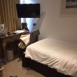 Single room with space for single bed and desk