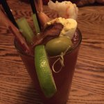 Loaded Bloody Mary with shrimp, deveiled egg, stuffed olive, lime