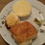 Eggs Meeting Street with cheese grits and a HUGE biscuit