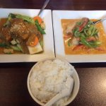 Left: Phad Puk Ruom (Garden Delight) Right: Panang Pla (Red Snapper Panang), and steamed rice.