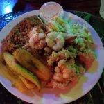 Grilled shrimp, cracked lobster, plaintains, rice and beans, fresh slaw