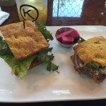 Grass fed burger on grain free focaccia. Pickled vegetables in small cup. Very filling!