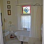 Original vintage claw foot tub and pedestal sink