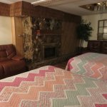 Gorgeous fireplace, leather reclining sofas, and real bedspreads
