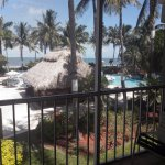View from screened room balcony with both pool and ocean view