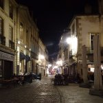 Quite close to the hotel: A cobble lane and bar by the Cathedral of Dijon