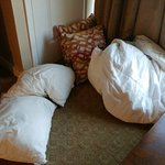 pillows in the floor with used linens