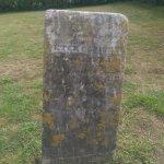 grave behind memorial
