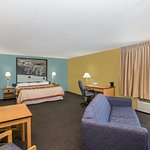 King Bed Suite with sofa, table and chairs,desk, chair, small refrigerator and microwave