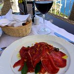 My favorite lunch at Hotel Villa Fraulo: beef carpaccio and red wine.