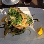 Grilled Fish fillet with steamed vegetables and rocket on potato rosti