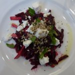 Beetroot, pear and goat's cheese salad spinkled with pine nuts.