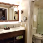 Lovely pocket door separating toilet/shower from sinks. Rain shower head plus 2nd hand held.