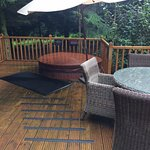 Hot tub and ourtdoor decking, bbq and table and chairs