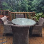 Outdoor decking with table and chairs secluded and private