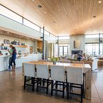 The modern tasting room offers indoor and outdoor lounge-style seating.