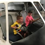 """Grandsons using their imagination to """"fly"""" in an authentic cockpit!"""