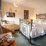 Room 3 Double ensuite with bath and shower, stunning antique brass captain's bed.