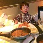 Rohaan enjoying his tikka chicken and poppadums ( with Mango chutney of course)
