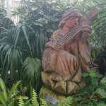A statue hidden amongst the greenery