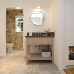 Automatic fireplace, bathroom with heated marble floor, double vanities, free standing tub.