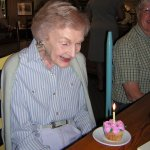 Mom is delighted with her 97 and 1/2 birthday cupcake.