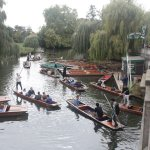 """Visitors enjoy a tour on the Cam, seated in a """"Punt"""""""