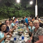 Eating with our guide and our drivers on the Saigon Foodie Tour!