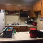 Small kitchen with microwave, coffee maker, toaster oven, fridge. Has dishes, wine glasses, etc.
