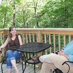 enjoying the relaxing deck of the Holly Rock Treehouse cabin