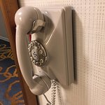 old style phone in hallway
