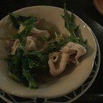 On Buta Shabu Salad: Mugi Fuji pork belly and pork loin with mizuna greens and kaiware sprouts,
