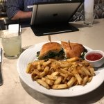 Rotisserie lamb sandwich and fries, margarita