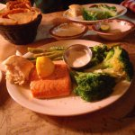 Cedar plank salmon, asparagus and broccoli. A huge basket of onion rings and pickled cukes