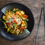 Wok fried calamari with pineapple, tomato, cucumber and herbs (Gluten Free, Dairy Free)