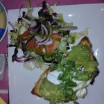 Crushed avocado and poached egg, with dressed salad