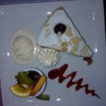 Bakewell tart with whipped cream and ice cream