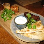 Wild boar and apple sausage roll; lamb kefte and flatbread