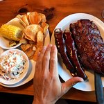 Look at the size of those ribs! Homemade chips, corn on cob and cole slaw on the side.