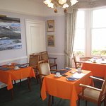 The breakfast room has superb sea views