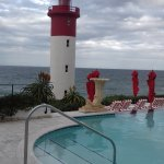 The Ocean Terrace overlooks the pool, lighthouse and sea. Very strinking with the red and white