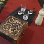 The bill was in the wooden box accompanied by complimentary liqueur and ice cream.