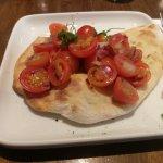 Bruchetta which was on a garlic flat bread! Tasted fresh and good