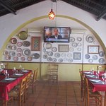 It is a comfortable restaurant with plates on the walls